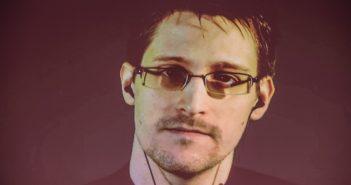Der US-amerikanischer Whistleblower Edward Snowden ist am 18.03.2015 in Hannover (Niedersachsen) bei einer Videoliveschalte auf einem Monitor zu sehen. (c) dpa