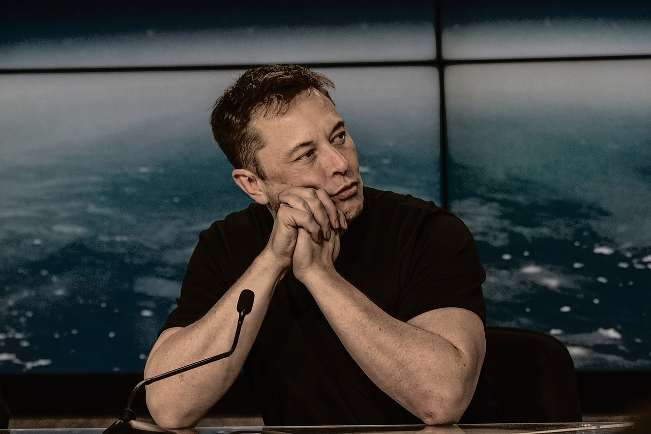 1280px-Elon_Musk_at_a_Press_Conference.jpg